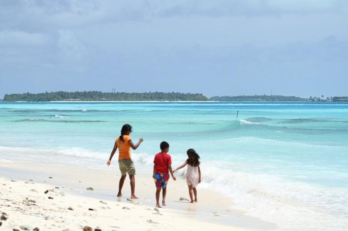 Beach time with niece and nephew in Alifu Dhaalu Atoll Maamigili, Maldives