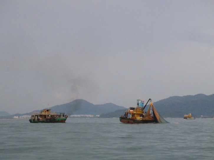 Fishing boats out early in the morning. Look at those huge nets.