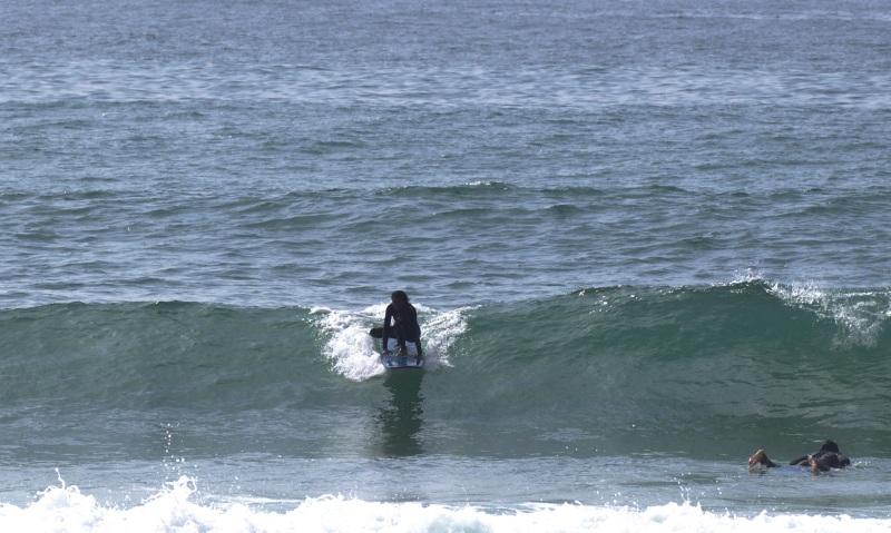 Crouching surfer?