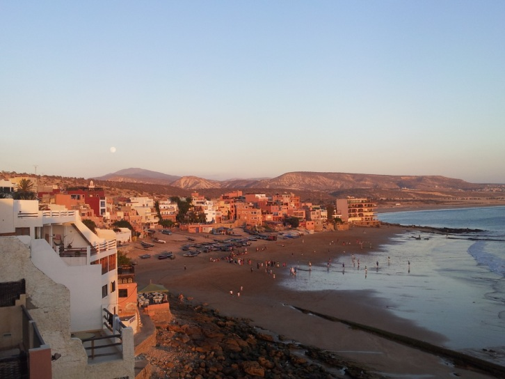 Sunset and full moon rise. Moroccans love beach football